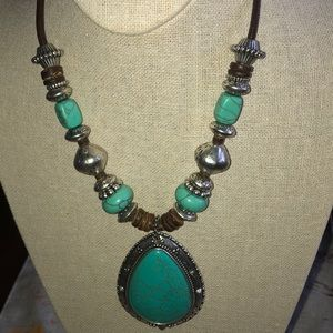 Chico's beautiful turquoise and silver necklace .